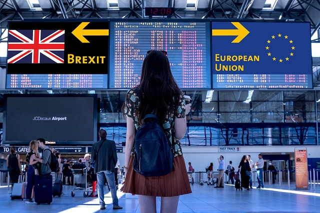 woman at airport with brexit and eu signs