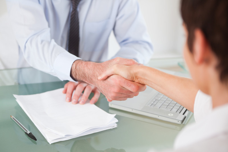 landlord and letting agent shaking hands