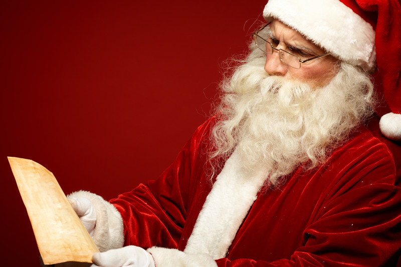 santa reading a letter from his landlord